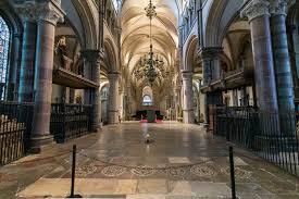 Interior of Canterbury Cathedral. A candle burns on the tiled floor to commemorate Becket's death.